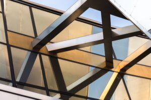 fragment-of-an-architectural-structure-made-of-gla-DKDQTCW
