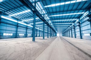 empty steel structure building, abandoned factory workshop or warehouse background