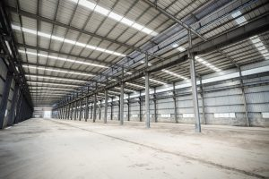 empty steel structure workshop, abandoned factory buildings or warehouse  background
