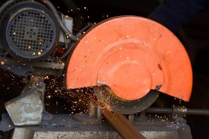 Worker cutting metal with grinder